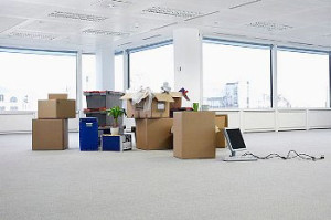 Empty office with moving boxes