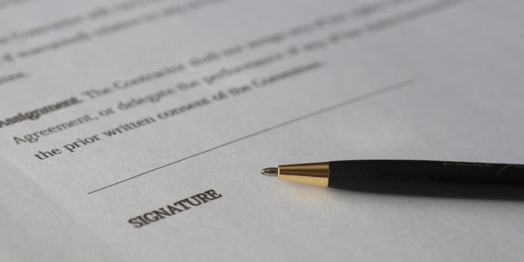 Pen next to signature line of contract