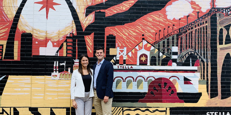 photo of interns in front of graffiti wall